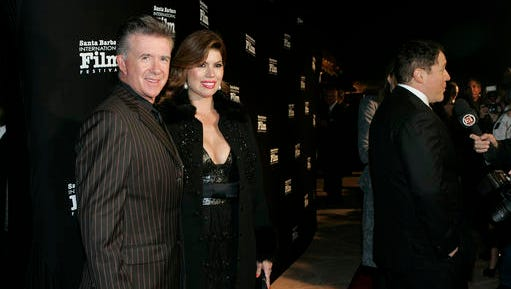 FILE - In this Nov. 19, 2010, file photo, Alan and Tanya Thicke pose on the red carpet before Santa Barbara International Film Festival. Tanya Thicke says her husband was laid to rest Monday, Dec. 19, 2016, six days after the actor suffered a fatal heart attack.