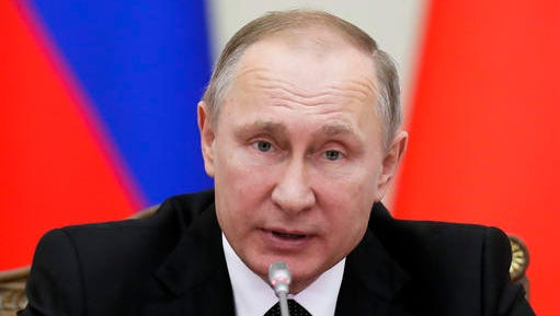 FILE _ In this Monday, Dec. 26, 2016 file photo Russian President Vladimir Putin speaks at the meeting in St.Petersburg, Russia. President Vladimir Putin said, Friday, Dec. 30, 2016 that Russia will not be expelling US diplomats in response to a new round of US sanctions.