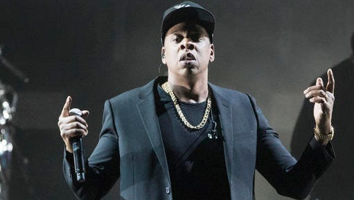 """FILE - In this Nov. 4, 2016 file photo, Jay Z performs during a campaign rally for Democratic presidential candidate Hillary Clinton in Cleveland. Jay Z will become the first rapper ever inducted into the Songwriters Hall of Fame when he enters the prestigious organization in June. The Songwriters Hall announced Wednesday, Feb. 22, 2017,  that songwriting heavyweights in the industry, including Kenneth """"Babyface"""" Edmonds, Max Martin and Jimmy Jam & Terry Lewis will also be part of its 2017 class."""