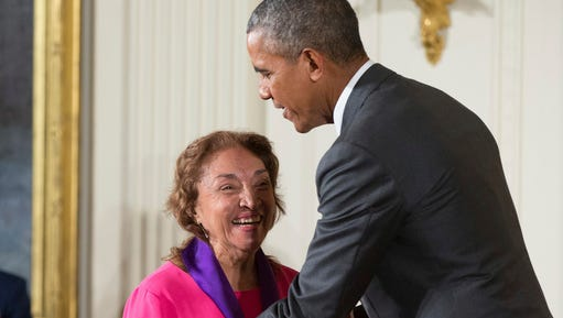 FILE - In this Sept. 10, 2015, file photo, President Barack Obama awards the 2014 National Medal of Arts to actress, theater founder, and director Miriam Colon of New York during a ceremony in the East Room at the White House in Washington. Colon, an icon in U.S. Latino theater who starred in films alongside Marlon Brando and Al Pacino, has died at age 80. Her husband, Fred Valle, told The Associated Press that Colon died early Friday, March 3, 2017, because of complications from a pulmonary infection.