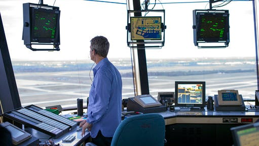 """FILE - In this Sept. 27, 2016, file photo, a FAA Air Traffic Controller works in the Dulles International Airport Air Traffic Control Tower in Sterling, Va. President Donald Trump is calling for privatizing the nation's air traffic control operations in his budget proposal, a top priority of the airline industry. The proposal says spinning off air traffic operations from the Federal Aviation Administration and placing them under an """"independent, non-governmental organization"""" would make the system """"more efficient and innovative while maintaining safety."""""""