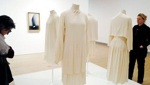 "In this March 16, 2017 photo, visitors to the Brooklyn Museum in New York look at tunics worn by artist Georgia O'Keeffe. The exhibit, ""Georgia O'Keeffe: Living Modern"" highlights her role as a style icon."