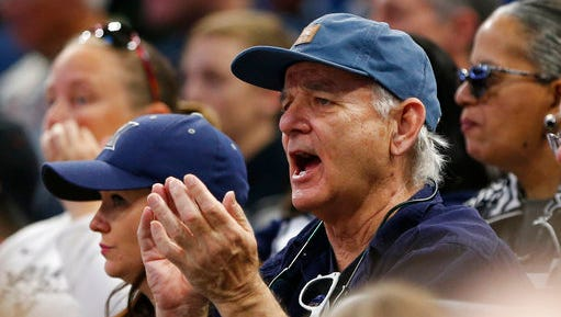 Actor and comedian Bill Murray cheers as he watches the first half of the first round of the NCAA college basketball tournament between Maryland and Xavier, Thursday, March 16, 2017 in Orlando, Fla.