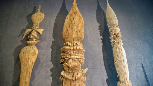 """This photo dated Monday, April 3, 2017 shows various types of """"fleche faitiere"""", decorated spears used by the Kanak to adorn their rooftops, on display at the Aguttes auction house in Neuilly sur Seine, outside Paris, France. A once-contested sale is going ahead in Paris of precious Kanak artifacts that were acquired by a private collector from the indigenous Melanesian inhabitants of New Caledonia. Nine wooden objects, including large decorative arrows dating from the 16th century, are to go under the hammer Tuesday."""