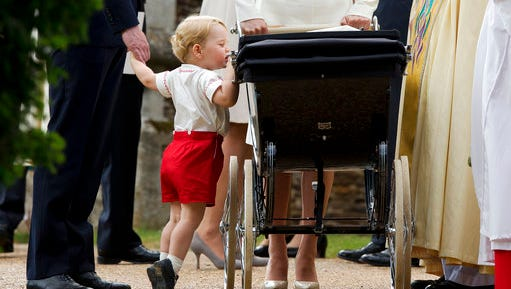 FILE - In this Sunday, July 5, 2015 file photo, Britain's Prince George gets up on tiptoes to peek into the pram of Princess Charlotte flanked by his parents Prince William and Kate the Duchess of Cambridge as they leave after Charlotte's Christening at St. Mary Magdalene Church in Sandringham, England. Kensington Palace said Monday April 10, 2017 that George, 3, and Charlotte, 1, will be page boy and bridesmaid at the May 20 nuptials of Middleton and financier James Matthews.