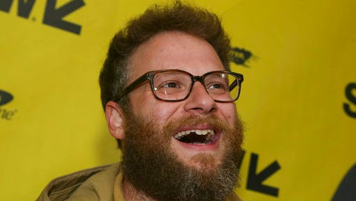 "FILE - In this March 12, 2017, file photo, Seth Rogen arrives for ""The Disaster Artist"" at the Paramount Theatre during the South by Southwest Film Festival in Austin, Texas. Rogen became an honorary member of the Pi Kappa Alpha fraternity chapter at the University of Vermont on April 17, 2017."