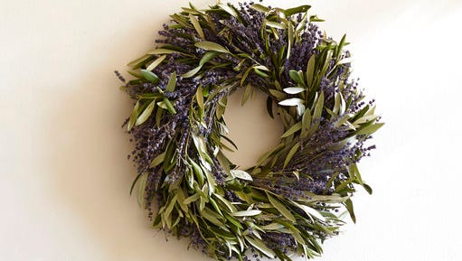 This undated photo provided by Pottery Barn shows their dried lavender and olive branch wreath which makes a fragrant, pretty addition to indoor or protected outdoor spaces.