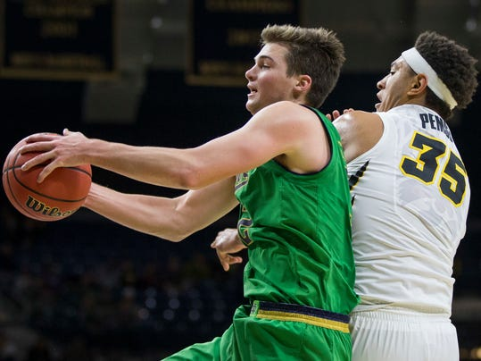 Notre Dame's Steve Vasturia (32), left, grabs a rebound next to Iowa's Cordell Pemsl (35) during the second half of an NCAA college basketball game Tuesday, Nov. 29, 2016, in South Bend, Ind. Notre Dame won, 92-78. (AP Photo/Robert Franklin)