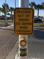 This sign is posted at the crosswalk by Flounders.