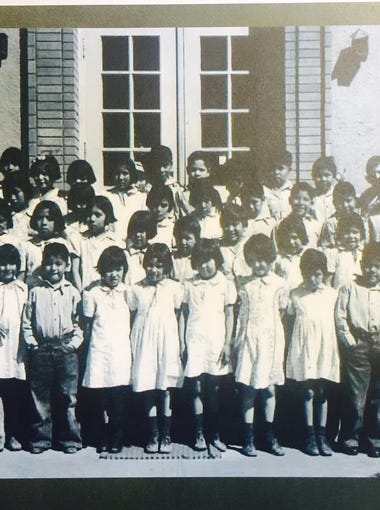 Native American children in front of the elementary school in this historical photo from the Phoenix Indian School Collection in the Billie Jane Baguley Library and Archives at the Heard Museum in Phoenix.