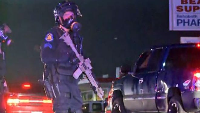 Police in riot gear in Ferguson, Missouri