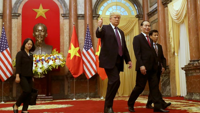 President Trump is pictured with Vietnamese President Tran Dai Quang at the Presidential Palace in Hanoi, Vietnam.