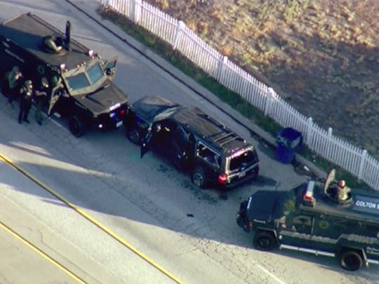 In this image taken from video, armored vehicles surround