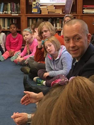 Richmond Mayor Dave Snow answers questions from students at Richmond Friends School.