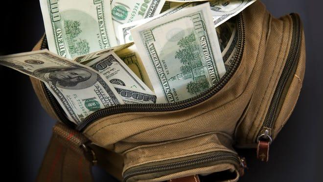 Dollars in bag.