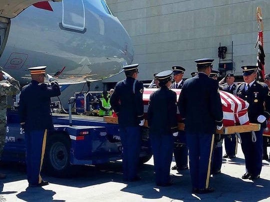 Army Sgt. Tyler Vaughan is received by military personnel in Los Angeles before being taken home to Visalia.