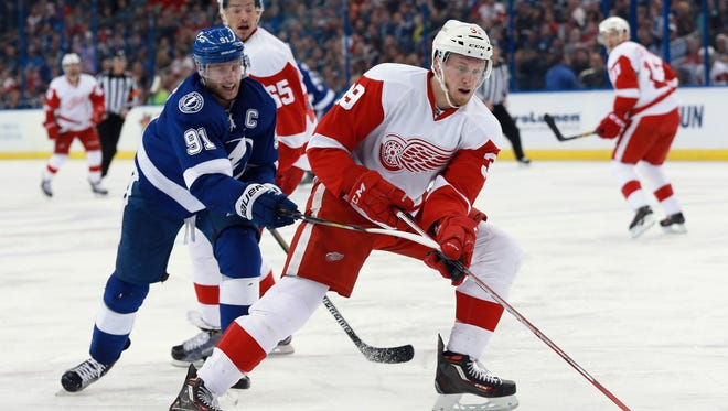 Tampa Bay Lightning center Steven Stamkos defends Detroit Red Wings right wing Anthony Mantha, right, during the second period at Amalie Arena.