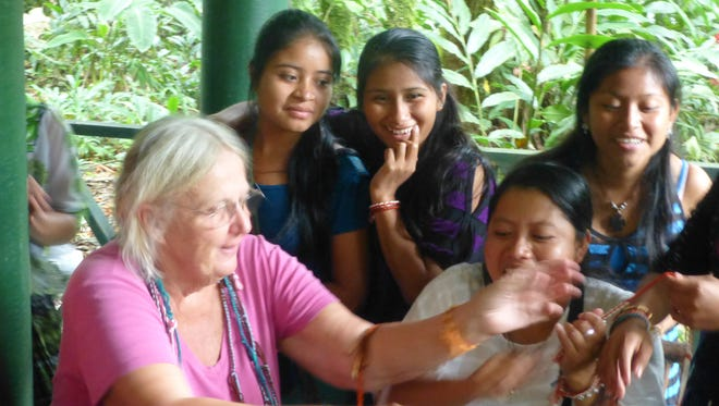 Weaver Doris Florig works with students in Guatemala. She will speak about her international weaving adventures on Oct. 6 at the DiFiore Center in St. George.