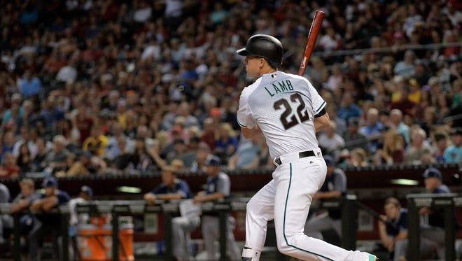 Sep 8, 2017; Phoenix, AZ, USA; Arizona Diamondbacks infielder Jake Lamb (22) hits an RBI double in the sixth inning against the San Diego Padres at Chase Field. Mandatory Credit: Jennifer Stewart-USA TODAY Sports