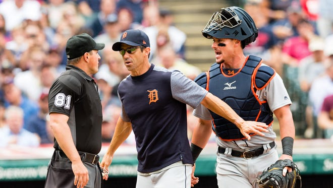 Umpire Quinn Wolcott listens as Tigers manager Brad Ausmus and catcher James McCann argue after both where thrown out of the game in the third inning at Progressive Field on Sept. 13, 2017 in Cleveland.
