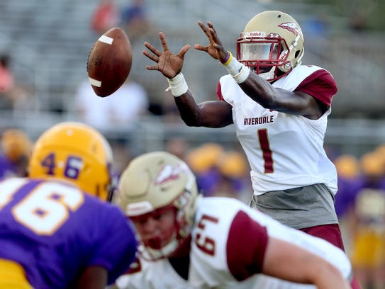 Riverdale's Marqwell Odom (1) grabs the snap during
