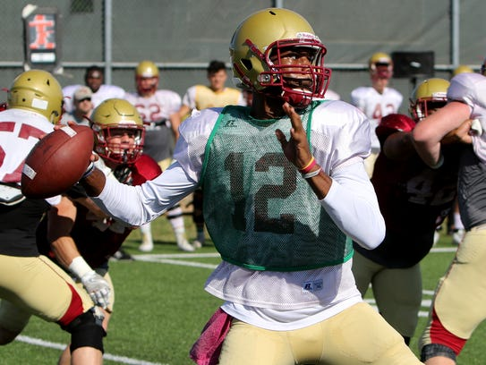Midwestern State's Javin Kilgo throws a pass Friday,