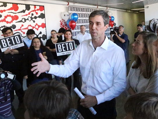 Beto O'Rourke, top, speaks to supporters during an event where he formally entered the race for the U.S. Senate in November at an office building in Downtown El Paso. Next to him is his wife, Amy O'Rourke.