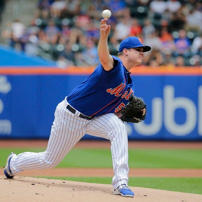 New York Mets pitcher Corey Oswalt throws during the