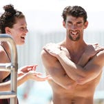 Allison Schmitt, left, and Michael Phelps won titles Friday at the Phillips 66 National Championships in San Antonio. Both are moving to Tempe to train with new ASU coach Bob Bowman.