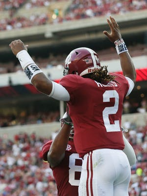Alabama quarterback Jalen Hurts celebrates after scoring a touchdown in the first half against Colorado State Saturday.