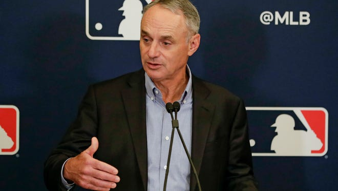 Baseball commissioner Rob Manfred said the owners and players union had agreed on a framework to start the season, but the union disagreed.