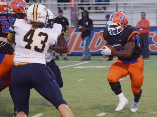 Louisiana College's Aurren Cooksey (25, center) looks to get past East Texas Baptist University (Marshall, Texas) defenders in a NCAA division III game played at Wildcat Stadium on the Louisiana College campus in Pineville, La., Saturday, Oct. 29, 2016.