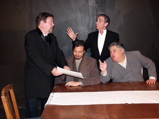 "Actors Marc Steffen, from left, Spencer Taylor, Mark Boudreau and Teddy Aspen-Sanchez discuss an issue in the play ""Enemy of the People."""