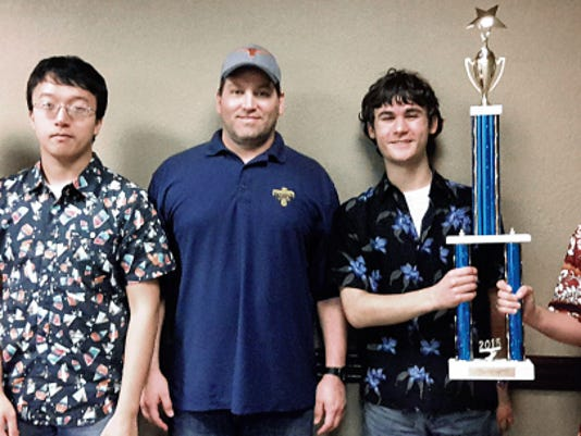 Coronado High School has won the Questions Unlimited national academic trivia competition, becoming the top high school quiz team in the nation. From left are Sheel Patel, Teddy Cai, coach Matthew Ballway, Andrew Paton and Luke Minton.