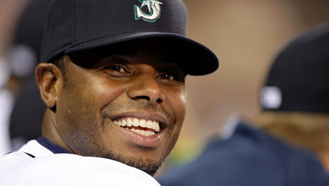 In this Sept. 15, 2009, file photo, Seattle Mariners' Ken Griffey Jr. smiles in the dugout during a baseball game against the Chicago White Sox in Seattle. The transcendent, once-in-a-generation athlete belonged to a little pocket of the country that never had the experience of the best athlete in their respective sport be theirs. And it's why when Griffey is all but certain to be announced as a Baseball Hall of Fame inductee next week, he'll take the entire Northwest with him to Cooperstown. (AP Photo/Elaine Thompson, File)