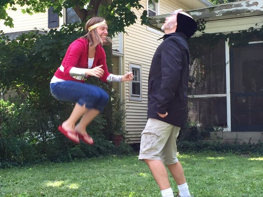 Joelle Baugher leaps over her arch nemesis InvenTOR in The Creative Minds shoot for the 48 Hour Film Project, a two day movie contest.