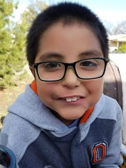 Israel Costilla, 8, of San Angelo, Texas, smiles for