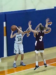 Malerie Taylor seems to be hemmed in by a St. Joseph