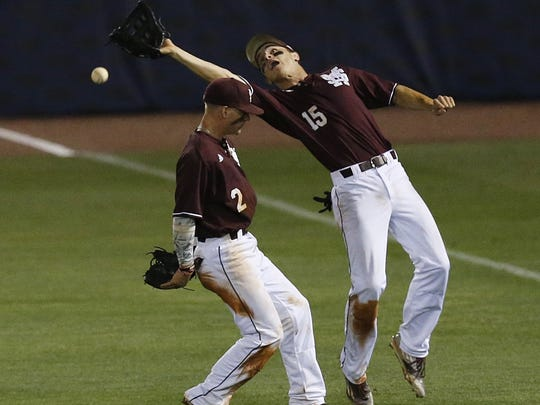 Mississippi St. infielder Hunter Stovall, left, and Mississippi St. outfielder Jake Mangum, right, both missed the pop fly against LSU during the inning seventh of a Southeastern Conference NCAA college baseball tournament game at the Hoover Met, Thursday, May 26, 2016, in Hoover, Ala. LSU won 6-2. (AP Photo/Brynn Anderson)