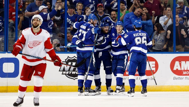 Lightning center Steven Stamkos (91) is congratulated after scoring a goal against the Red Wings during the second period at Amalie Arena on Thursday.