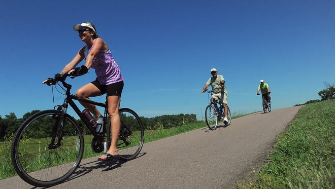 Riders head south near 49th Street along the bike trail during Tour Sioux in 2015.
