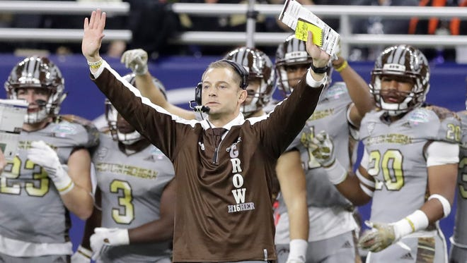 Western Michigan head coach P.J. Fleck signals during the first half of the Mid-American Conference championship NCAA college football game against Ohio, Friday, Dec. 2, 2016, in Detroit. (AP Photo/Carlos Osorio)