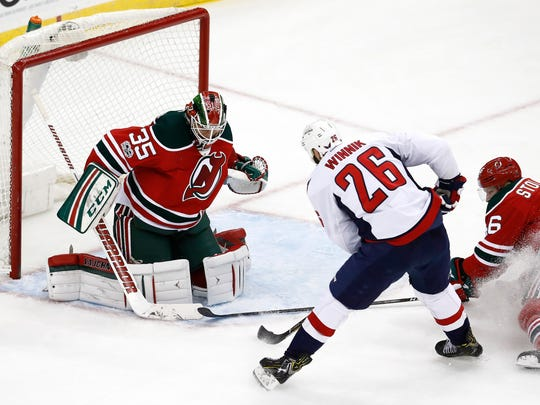 """""""I don't think there's any panic or that kind of feeling in the room,"""" said Devils goalie Schneider (35). """"It's not going to get easier, it's going to get harder. We have to recognize that."""""""