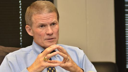 Corrections Commissioner Marshall Fisher changed the reimbursement for counties keeping state inmates to save $3.2 million.