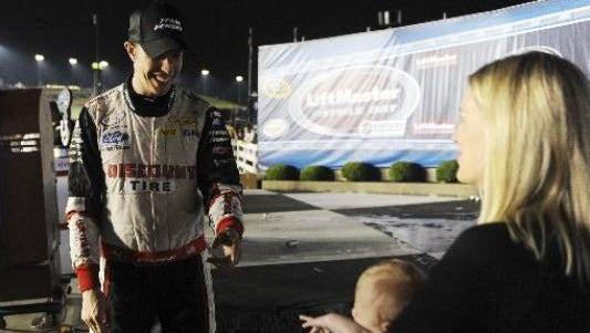 Brad Keselowski with his wife and infant daughter.