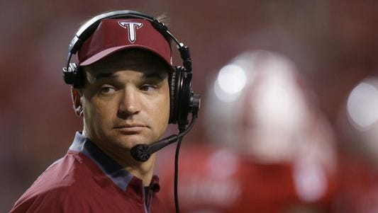 Troy coach Neal Brown looks on during the second half of an NCAA college football game against North Carolina State in Raleigh, N.C., Saturday, Sept. 5, 2015. North Carolina State won 49-21.