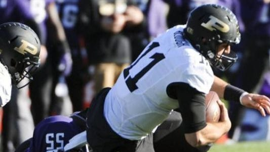 Purdue quarterback David Blough is brought down against Northwestern.