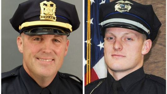 Des Moines police Sgt. Anthony Beminio and Urbandale police Officer Justin Martin