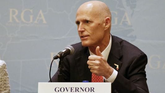 Florida Gov. Rick Scott answers questions during the Republican Governors Association annual conference Tuesday, Nov. 15, 2016, in Orlando.