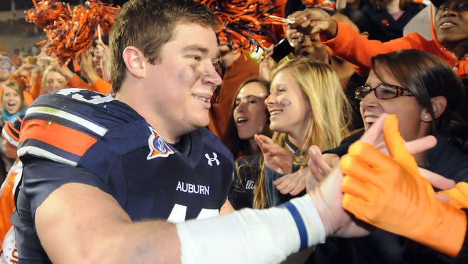 File photo shows Philip Lutzen- kirchen celebrating the Tigers? victory over Ole Miss on Oct. 29, 2011, at Jordan- Hare Stadium  in Auburn.